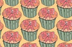χαριτωμένο άνευ ραφής διάνυσμα προτύπων Cupcake με το ρόδινο τόξο στο πορτοκαλί υπόβαθρο Χρωματισμένη χέρι απεικόνιση Στοκ Φωτογραφία