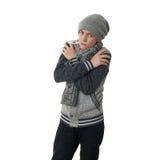 Χαριτωμένο αγόρι εφήβων στο γκρίζο πουλόβερ πέρα από απομονωμένο το λευκό υπόβαθρο Στοκ φωτογραφία με δικαίωμα ελεύθερης χρήσης