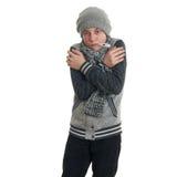 Χαριτωμένο αγόρι εφήβων στο γκρίζο πουλόβερ πέρα από απομονωμένο το λευκό υπόβαθρο Στοκ Φωτογραφίες