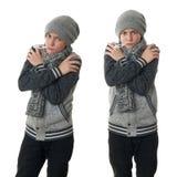 Χαριτωμένο αγόρι εφήβων στο γκρίζο πουλόβερ πέρα από απομονωμένο το λευκό υπόβαθρο Στοκ Φωτογραφία