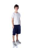 Χαριτωμένο αγόρι teeange που στέκεται στο άσπρο υπόβαθρο Στοκ εικόνα με δικαίωμα ελεύθερης χρήσης