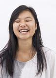 Χαριτωμένο ασιατικό κορίτσι στο απομονωμένο υπόβαθρο Στοκ Εικόνα