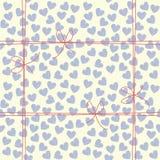 Χαριτωμένο ατελείωτο σχέδιο με τις μπλε καρδιές και τα κόκκινα τόξα Στοκ Εικόνα