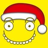 Χαριτωμένο κίτρινο πρόσωπο κινούμενων σχεδίων με το καπέλο Άγιου Βασίλη Στοκ Φωτογραφία