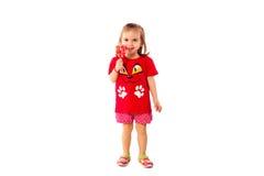 Χαριτωμένο μικρό κορίτσι με ένα lollipop Στοκ Φωτογραφίες