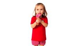 Χαριτωμένο μικρό κορίτσι με ένα lollipop Στοκ Εικόνες