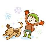 Χαριτωμένο παιχνίδι αγοριών και σκυλιών στο χιόνι απεικόνιση αποθεμάτων