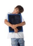 Χαριτωμένο παιδί που αγκαλιάζει το μικρό πίνακα Στοκ φωτογραφίες με δικαίωμα ελεύθερης χρήσης