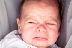 Χαριτωμένο τεσσάρων μηνών να φωνάξει αγοράκι Στοκ φωτογραφία με δικαίωμα ελεύθερης χρήσης