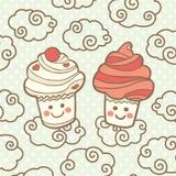 Χαριτωμένο χαμόγελο δύο cupcakes στα σύννεφα Απεικόνιση αποθεμάτων