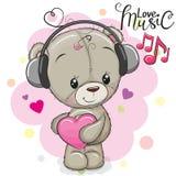 Χαριτωμένο Teddy αντέχει με τα ακουστικά απεικόνιση αποθεμάτων