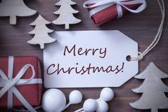 Χαρούμενα Χριστούγεννα δέντρων δώρων ετικετών Στοκ Εικόνα