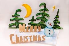 Χαρούμενα Χριστούγεννα και χιονάνθρωπος Στοκ Φωτογραφίες
