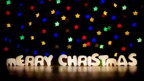 Χαρούμενα Χριστούγεννα με τα πολύχρωμα αστέρια Στοκ εικόνες με δικαίωμα ελεύθερης χρήσης