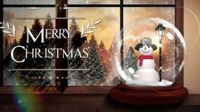 Χαρούμενα Χριστούγεννα που χαιρετά με τη σφαίρα χιονιού απόθεμα βίντεο