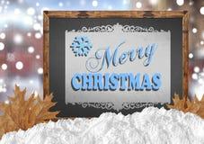 Χαρούμενα Χριστούγεννα στον πίνακα με τα φύλλα και το χιόνι πόλεων Στοκ εικόνα με δικαίωμα ελεύθερης χρήσης
