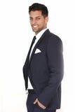 Χαλαρωμένος επιτυχής όμορφος επιχειρηματίας στοκ φωτογραφία