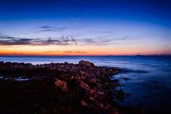 Χαλαρώνοντας ηλιοβασίλεμα ακτών Στοκ Φωτογραφίες