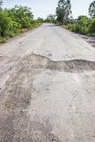 Χαλασμένος δρόμος στην επαρχία Στοκ φωτογραφία με δικαίωμα ελεύθερης χρήσης