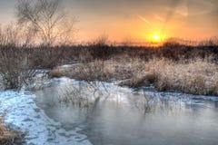 Χειμερινές ηλιοβασίλεμα και λίμνη Στοκ Εικόνες