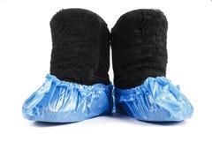 Χειμερινές μπότες στις καλύψεις μποτών στοκ φωτογραφίες