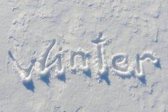 Χειμερινή λέξη που γράφεται στο χιόνι Στοκ εικόνα με δικαίωμα ελεύθερης χρήσης