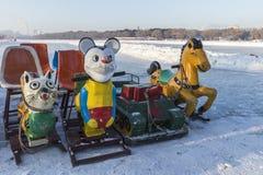 Χειμερινή παιδική χαρά ελκήθρων Στοκ Φωτογραφίες