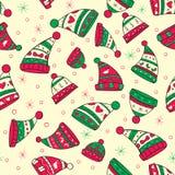 Χειμερινό άνευ ραφής σχέδιο με τα κόκκινος-πράσινα καπέλα Στοκ εικόνα με δικαίωμα ελεύθερης χρήσης