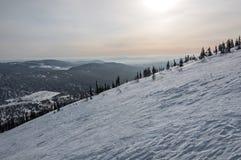 Χειμερινό ηλιοβασίλεμα χιονιού βουνοπλαγιών Στοκ φωτογραφίες με δικαίωμα ελεύθερης χρήσης
