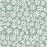 Χειμερινό πρότυπο με snowflakes σε μια πράσινη ανασκόπηση Στοκ Εικόνες