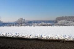 Χειμερινό τοπίο καλλιεργήσιμων εδαφών Στοκ Εικόνες