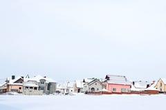 Χειμερινό τοπίο με τα σπίτια Στοκ Φωτογραφίες