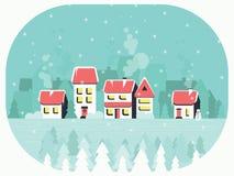 Χειμερινό υπόβαθρο με ένα ειρηνικό χωριό στο χιόνι και τα δέντρα Στοκ Φωτογραφίες