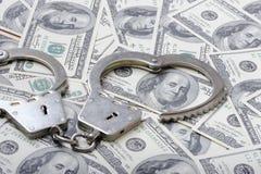 Χειροπέδες δολάρια Στοκ φωτογραφία με δικαίωμα ελεύθερης χρήσης
