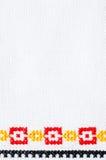 Χειροποίητη κεντητική στοιχείων από τη διαγώνια βελονιά Υπόβαθρο με τη γεωμετρική διακόσμηση Στοκ Φωτογραφία
