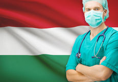 Χειρούργος με τη εθνική σημαία στη σειρά υποβάθρου - Ουγγαρία Στοκ Εικόνα