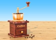 Χειρωνακτικός μύλος καφέ με τα φασόλια καφέ στον ξύλινο πίνακα, τρισδιάστατο απεικόνιση αποθεμάτων
