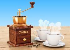 Χειρωνακτικός μύλος καφέ με τα φασόλια φλιτζανιών του καφέ και καφέ απεικόνιση αποθεμάτων