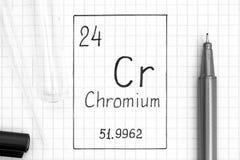 Χημικό χρώμιο χρωμίου στοιχείων γραφής με τη μαύρη μάνδρα, το σωλήνα δοκιμής και το σιφώνιο στοκ εικόνες
