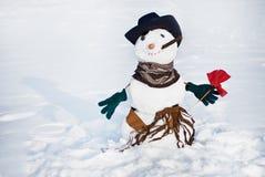 Χιονάνθρωποι με το λουλούδι Στοκ Φωτογραφίες