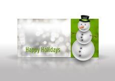 Χιονάνθρωπος στη ευχετήρια κάρτα Χριστουγέννων Περίληψη bokeh backgroun Στοκ Εικόνες