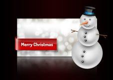 Χιονάνθρωπος στη ευχετήρια κάρτα Χριστουγέννων Περίληψη bokeh backgroun Στοκ φωτογραφία με δικαίωμα ελεύθερης χρήσης