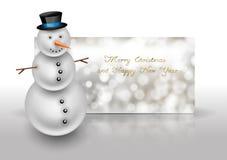 Χιονάνθρωπος στη ευχετήρια κάρτα Χριστουγέννων Περίληψη bokeh backgroun Στοκ φωτογραφίες με δικαίωμα ελεύθερης χρήσης