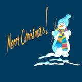 Χιονάνθρωπος Χριστουγέννων σε ένα μπλε υπόβαθρο Στοκ Εικόνες