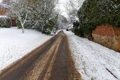 Χιονισμένος δρόμος κατευθείαν Στοκ Εικόνες