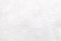 Χιονώδες άσπρο υπόβαθρο Χριστουγέννων με τα αστέρια Στοκ Εικόνα