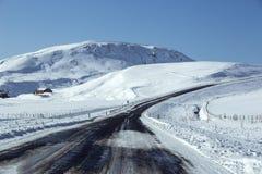 Χιονώδης δρόμος στο wintertime Στοκ Φωτογραφία