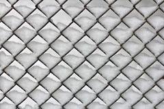 Χιονώδης φράκτης συνδέσεων αλυσίδων Στοκ Φωτογραφία