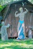 Χιουμοριστικός αριθμός και άγαλμα οικοδόμων σωμάτων στη διάσταση 2, στοκ φωτογραφίες