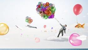 Χιουμοριστικός τύπος με τα μπαλόνια στοκ εικόνα με δικαίωμα ελεύθερης χρήσης
